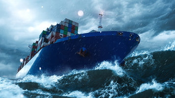 Cargo ship in stormy seas