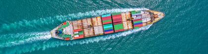 Blank Sailings On The Rise Again in Q2 2020, a container ship sails across the ocean